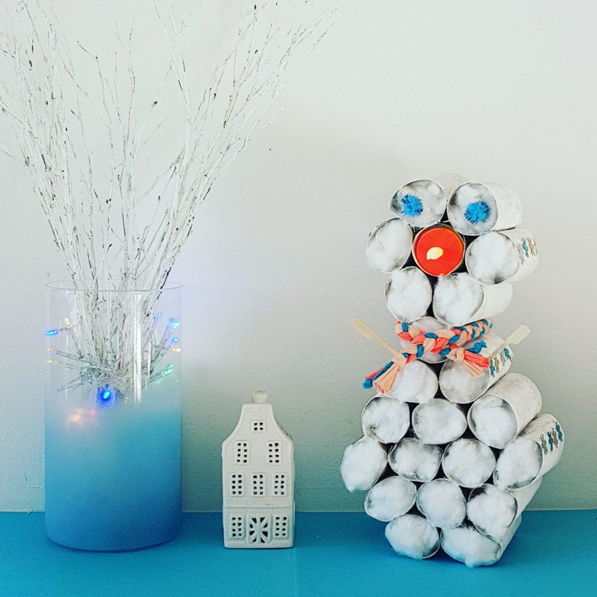 Sneeuwpop knutselen in de winter