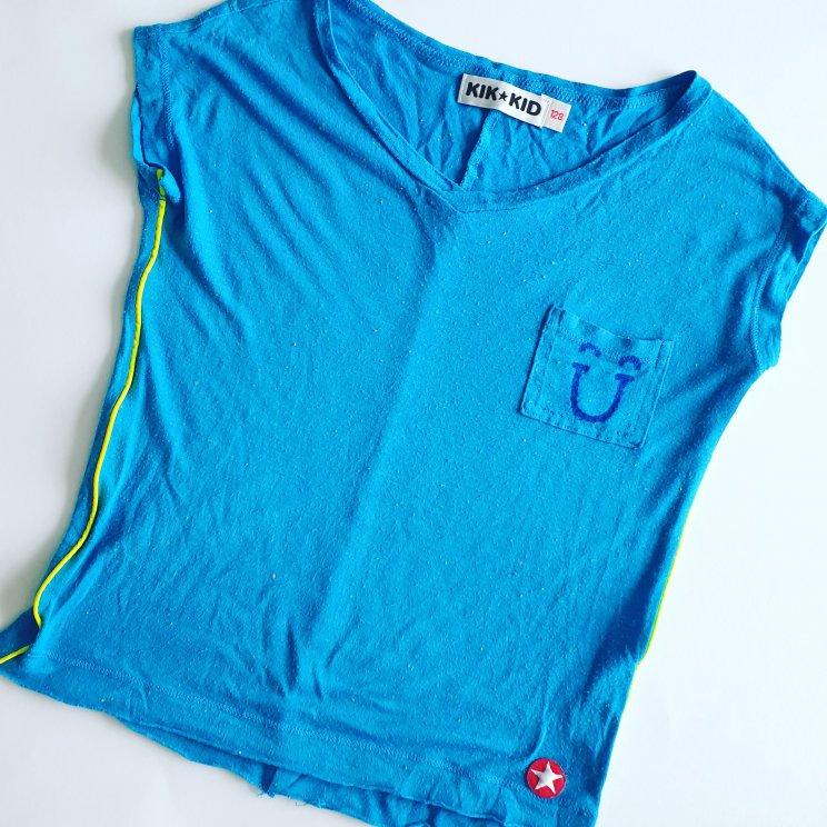 Kinderkleding versieren met textielstiften: leuke ideeën om te knutselen - shirt met smiley